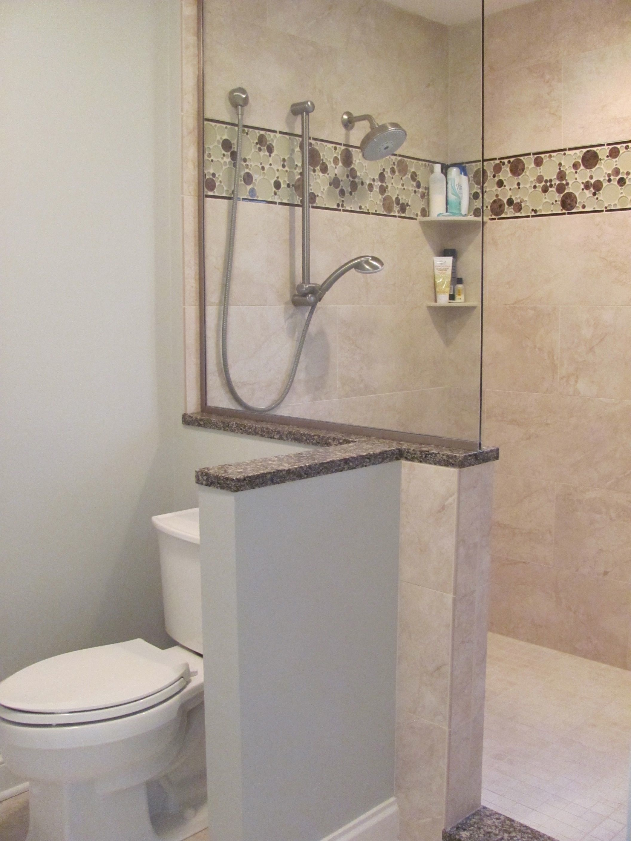 Combined shower & toilet area create enlarged shower & privacy.