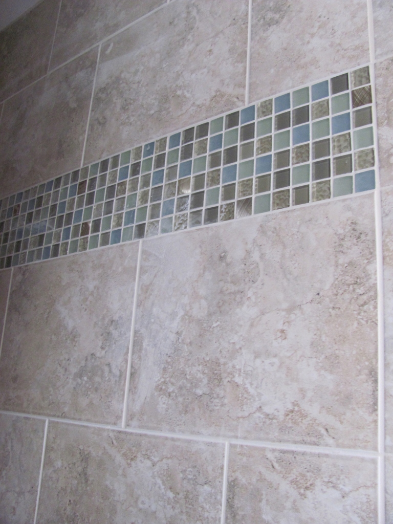 Glass mosaic add color & sparkle to the shower