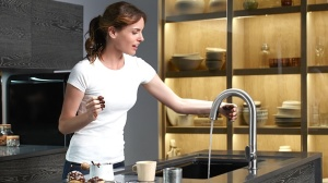 Sensor faucets make kitchen clean up easy for all generations.