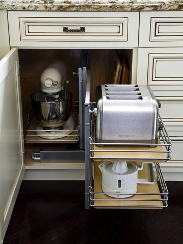 Storage designed in cabinetry for appliances