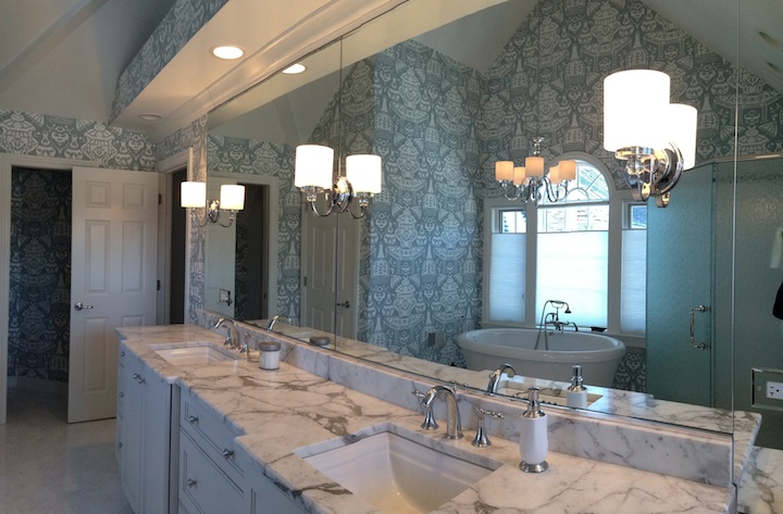 The mirror adds light & visually enlarges this Naperville Master Bath Remodel.