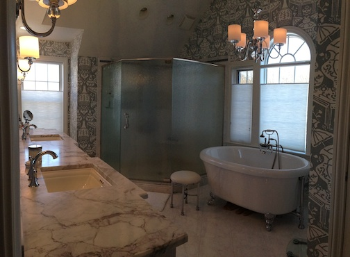 Corner shower and step water jet tub set the stage for R & R